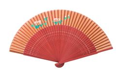 Red fan with flower pattern. A red Asian fan wit a flower pattern, isolated on white Royalty Free Stock Images