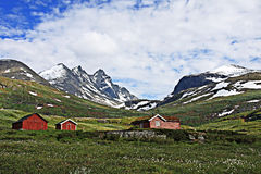 Red farm in the mountains in Norway Stock Photo