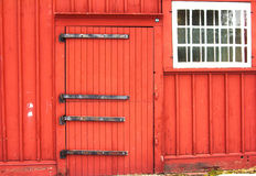red farm with white window stock photography