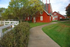 Red farmhouse. Charming red farmhouse and manicured lawn Stock Photography