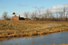 The red farmhouse in fall Stock Photography