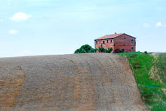 Red farmhouse in Italy Royalty Free Stock Photography