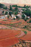 Red farmland with village in dongchuan of china Stock Images