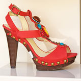 Red fashion shoe with decoration. Royalty Free Stock Photos