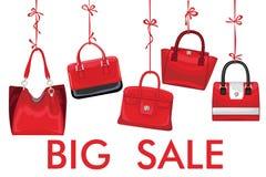 Red fashion women's handbag hang on ribbon.Big sale Stock Photos