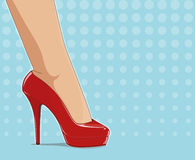 Red fashionable shoes on female foot Royalty Free Stock Images