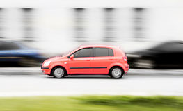 Red fast car. Run on the road. photography Royalty Free Stock Photo