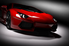 Red fast sports car in spotlight, black background. Shiny, new, luxurious. Stock Image