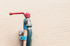 Red faucet and blue PVC pipe. With rubber tube Stock Photos