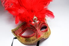 Red feather. And dance mask Stock Images