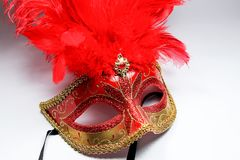 Red feather. And dance mask Royalty Free Stock Photos