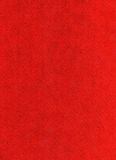 Red felt background. Red felt fabric close-up of a textile fabric background Stock Image