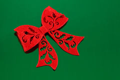 Red Felt Bow on Green Stock Photography