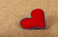 Red felt craft heart over canvas close up Stock Photos