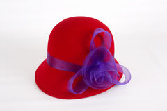 Red Felt Hat with Purple Ribbon Stock Image