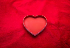 Red felt with heart. Background Valentine's Day Stock Photo