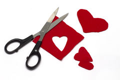 Red Felt Heart Cut-Outs - Crafts. Red felt hearts cut-out with scissors isolated on white background stock photography