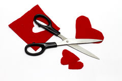 Red Felt Heart Cut-Outs - Crafts. Red felt hearts cut-out with scissors isolated on white background royalty free stock images