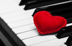 Red felt heart on piano keyboard Stock Photo