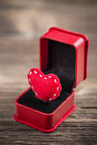 Red felt heart in ring box Stock Photo