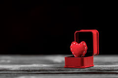 Red felt heart in ring box Royalty Free Stock Photos