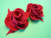 Red felt roses Stock Images