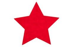 Red felt star. A red felt star isolated on white Stock Photos
