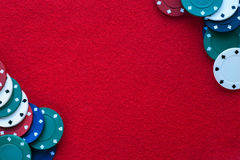 Red felt table with poker chips over it and copy space. Casino,. Gambling, poker and roulette theme background stock photo