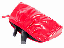 The red female handbag with cosmetics Stock Images