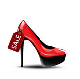 Red female hi heel shoes with sale label. Concept for shopping and discount Royalty Free Stock Image
