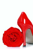 Red female shoes with high heels and a flower. Royalty Free Stock Photography