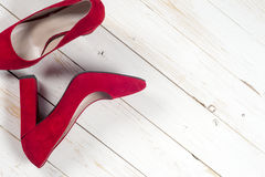 Red female shoes on high heels Royalty Free Stock Photo