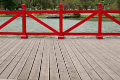Red fence. With wood board in park Royalty Free Stock Photo