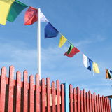 Red fence and flags Royalty Free Stock Photo