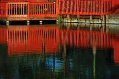 Red fence on the river Royalty Free Stock Photography