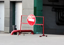 red fence and a sign forbidding entry into the enterprise through the arch. Royalty Free Stock Photo