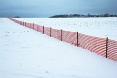 Red fence at winter Stock Photo