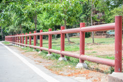 Red fences and tree Stock Photo