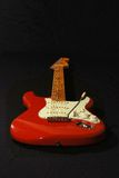 Red Fender copy guitar. Red Fender copy guitar with black background Stock Image
