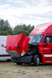 Red fensy commercial semi truck rig with open hood Stock Image