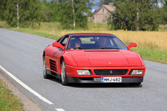 Red Ferrari 348 Cruising Along Country Road stock photo