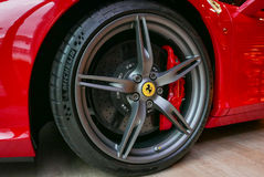 Red Ferrari F430 Scuderia Front Wheel brake system with logotype. Close up of Red Ferrari F430 Scuderia Front Wheel brake system with logotype. at Bangkok Royalty Free Stock Images
