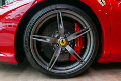 Red Ferrari F430 Scuderia Front Wheel brake system with logotype. Close up of Red Ferrari F430 Scuderia Front Wheel brake system with logotype. at Bangkok Stock Photos
