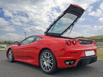 Red ferrari f430 with tailgate open Stock Photos