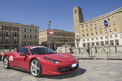 Red ferrari on the road Royalty Free Stock Photo