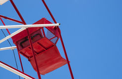 Red ferris wheel against a sky Stock Photos