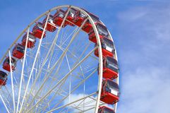 Red ferris wheel with blue sky. Giant Ferris wheel at carnival with blue sky Stock Photos