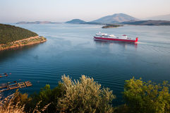 Red ferryboat. Navigate in the Gulf of Igoumenitsa to arrive in Italy Royalty Free Stock Photography