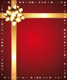 Red festive background with golden bow. Stock Photos