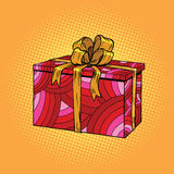 Red festive box, tied with a gold ribbon. Pop art retro vector. Birthday, Christmas and New year Stock Photography